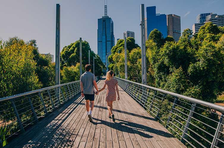 couple walking park visit australia